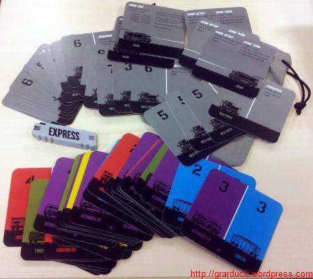 Une fois le contenu déballé : cartes wagons, extensions, jeton de 1er joueur, bourse de transport